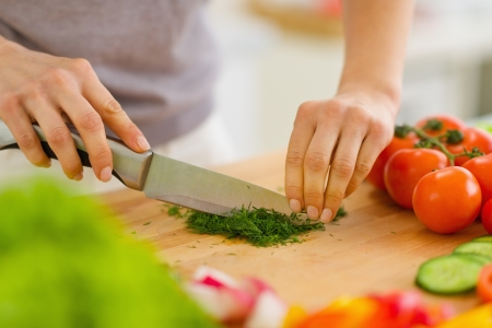 Closeup on woman cutting fresh dill Stock Photo