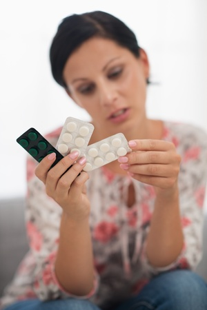 Closeup on pills in hand of concerned young woman Stock Photo - 18493174
