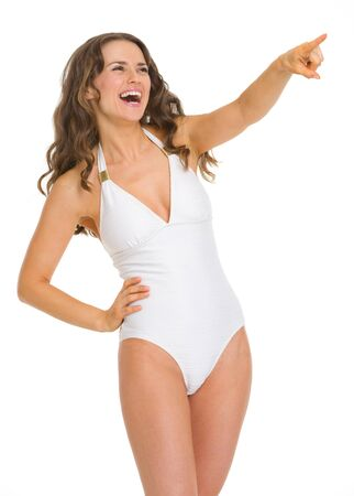 Portrait of young woman in swimsuit pointing on copy space Stock Photo - 18625019