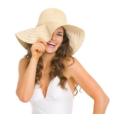 Smiling young woman in swimsuit playing with hat Stock Photo - 18625005