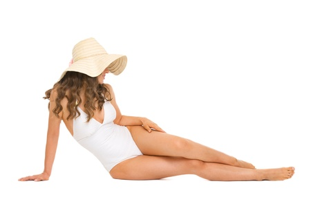 Young woman in swimsuit and hat laying on floor Stock Photo - 18625075