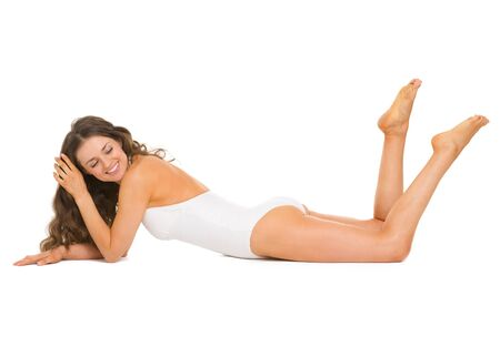 Happy young woman in swimsuit and hat laying on floor Stock Photo - 18625144