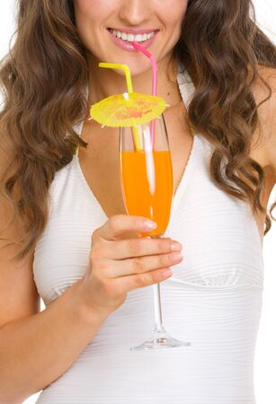 Closeup on young woman in swimsuit drinking cocktail Stock Photo - 18624940