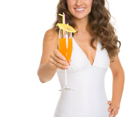 Closeup on young woman in swimsuit giving cocktail Stock Photo - 18625078