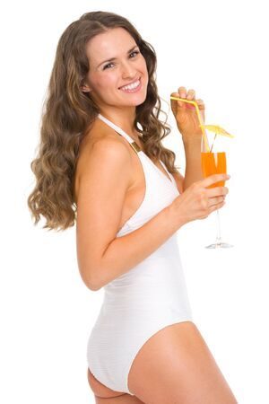 Happy young woman in swimsuit with cocktail Stock Photo - 18624944