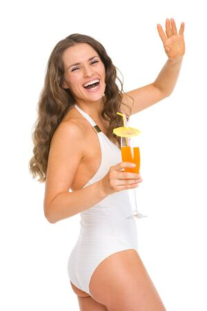 Happy young woman in swimsuit with cocktail saluting Stock Photo - 18624987