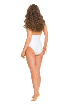 Full length portrait of young woman in swimsuit going straight . rear view Stock Photo - 18625137