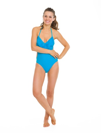 Full length portrait of smiling young woman in swimsuit Stock Photo - 18625126