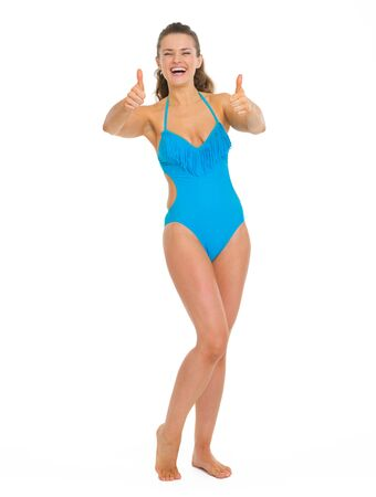 Full length portrait of happy young woman in swimsuit showing thumbs up Stock Photo - 18625128