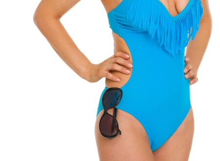 Closeup on sunglasses hanging on swimsuit Stock Photo - 18625015