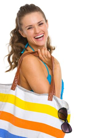 Portrait of smiling young woman in swimsuit with beach bag Stock Photo - 18625007