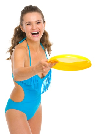 Happy young woman in swimsuit playing with frisbee Stock Photo - 18625089