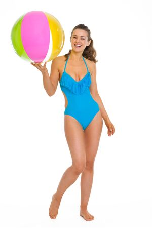 Full length portrait of smiling young woman in swimsuit with beach ball Stock Photo - 18625090