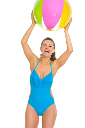 Happy young woman in swimsuit playing with beach ball Stock Photo - 18625088