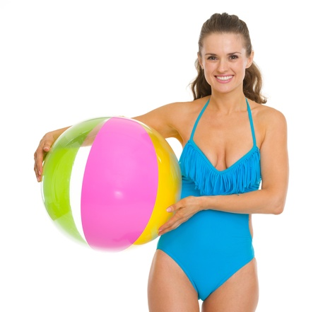 Smiling young woman in swimsuit holding beach ball Stock Photo - 18625091