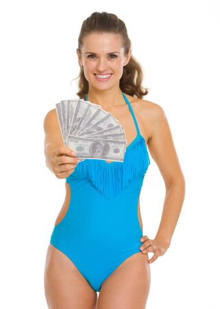 Smiling young woman in swimsuit showing fan of dollars Stock Photo - 18625018