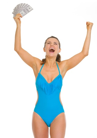 Happy young woman in swimsuit with fan of dollars rejoicing success Stock Photo - 18625082