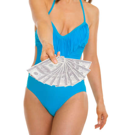 Closeup on fan of dollars in hand of young woman in swimsuit Stock Photo - 18625092