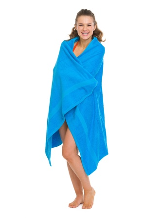 Happy young woman in swimsuit bundle up in towel Stock Photo - 18625024