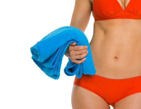 Closeup on towel in hand of young woman in swimsuit Stock Photo - 18624930