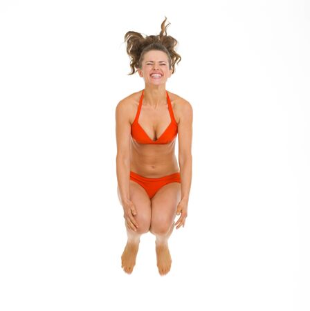Happy young woman in swimsuit jumping in water Stock Photo - 18625125