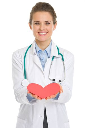 Closeup on medical doctor woman giving paper heart Stock Photo - 18624879