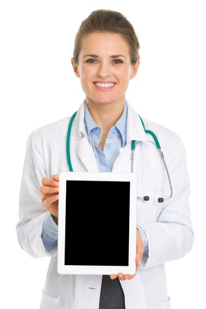 topicality: Smiling medical doctor woman showing tablet pc