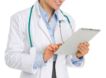 topicality: Closeup on medical doctor woman using tablet pc
