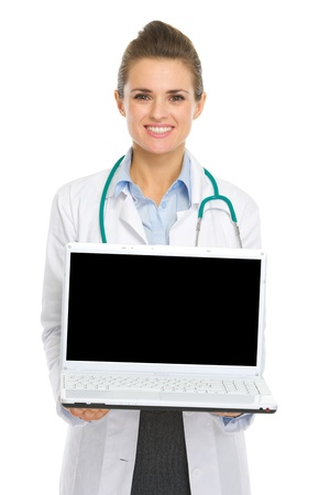 topicality: Smiling medical doctor woman showing laptop