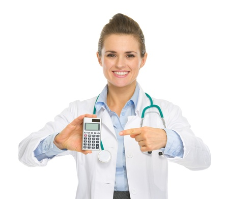 Smiling medical doctor woman pointing calculator Stock Photo - 18624902