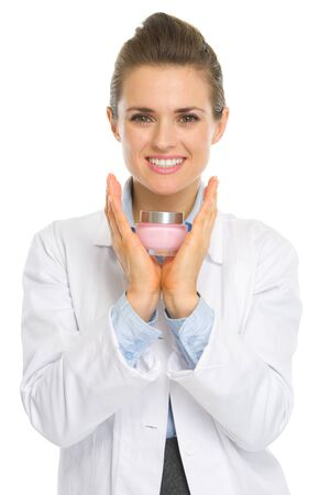 cosmetologist: Happy cosmetologist woman showing creme Stock Photo