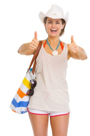 Smiling young beach woman in hat showing thumbs up Stock Photo - 18660030