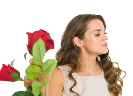 displeased: Displeased young woman taking flowers