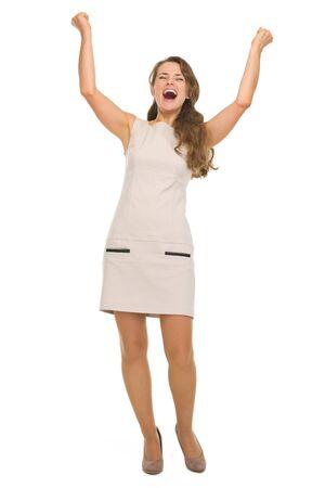 rejoicing: Full length portrait of happy young woman rejoicing success