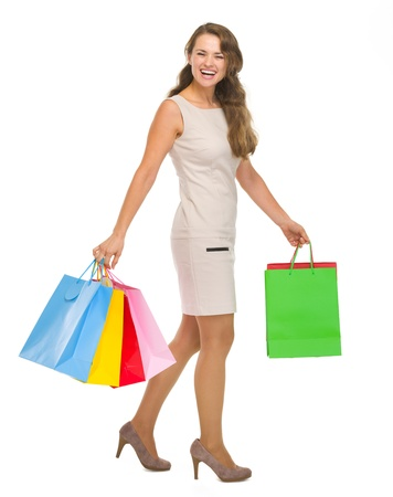 Full length portrait of happy young woman with shopping bags Stock Photo - 18788210