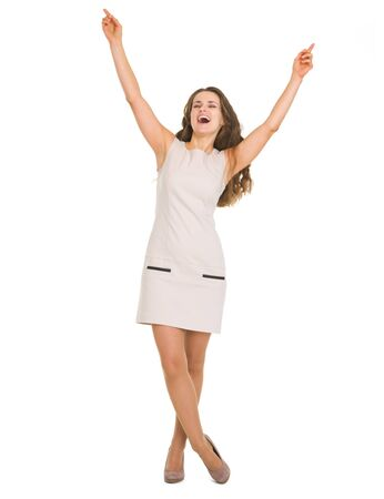 Full length portrait of happy young woman rejoicing success photo