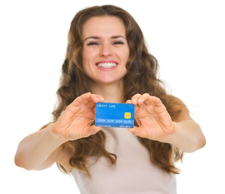 Closeup on credit card in hands of happy young woman Stock Photo - 18788206