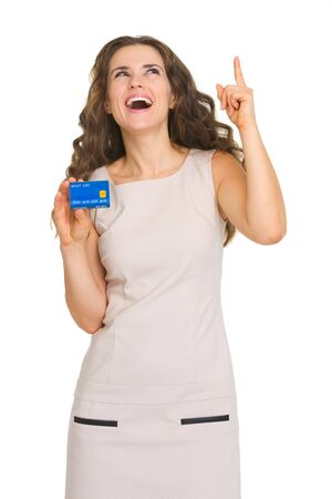 Happy young woman with credit card pointing on copy space Stock Photo - 18788096