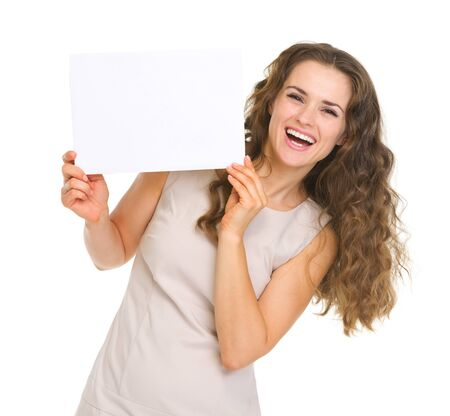 Happy young woman showing blank paper Stock Photo - 18788101