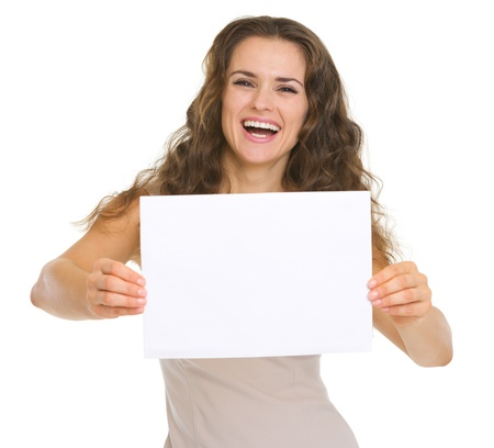 Happy young woman showing blank paper Stock Photo - 18788209