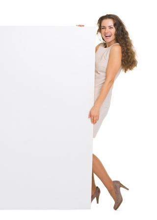 Full length portrait of smiling young woman holding blank billboard Stock Photo - 18788144