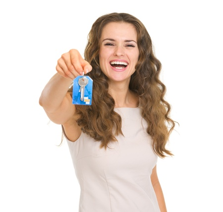 Portrait of smiling young woman showing house key Stock Photo - 18788207