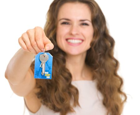 Closeup on house key in woman hand Stock Photo - 18788173