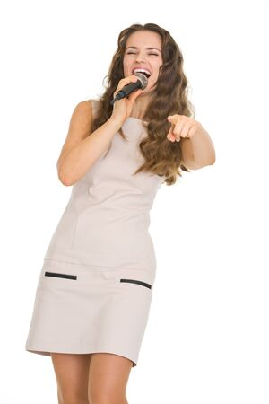 Happy young woman with microphone pointing in camera Stock Photo - 18788152