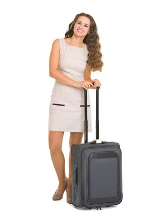 Full length portrait of smiling young woman with wheel bag Stock Photo - 18788149
