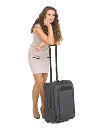 Full length portrait of frustrated young woman with wheel bag Stock Photo - 18788166