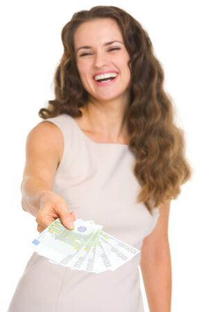 Closeup on fun of euros in hand happy young woman Stock Photo - 18788164