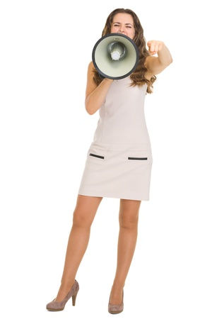 Full length portrait of young woman shouting through megaphone and pointing in camera Stock Photo - 18788208