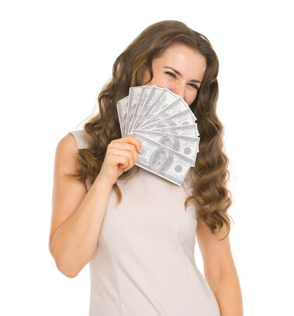 Portrait of happy young woman hiding behind fan of dollars Stock Photo - 18788171