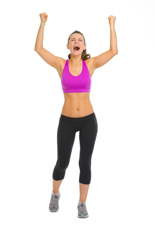 Full length portrait of fitness young woman rejoicing success Stock Photo - 18911844